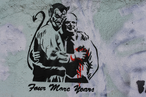 Stencil of devil holding McCain's heart