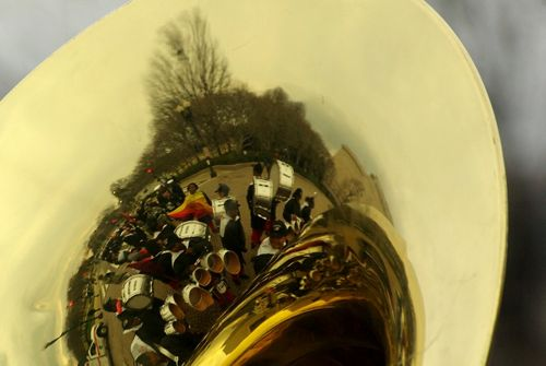 Marching band reflected in tuba
